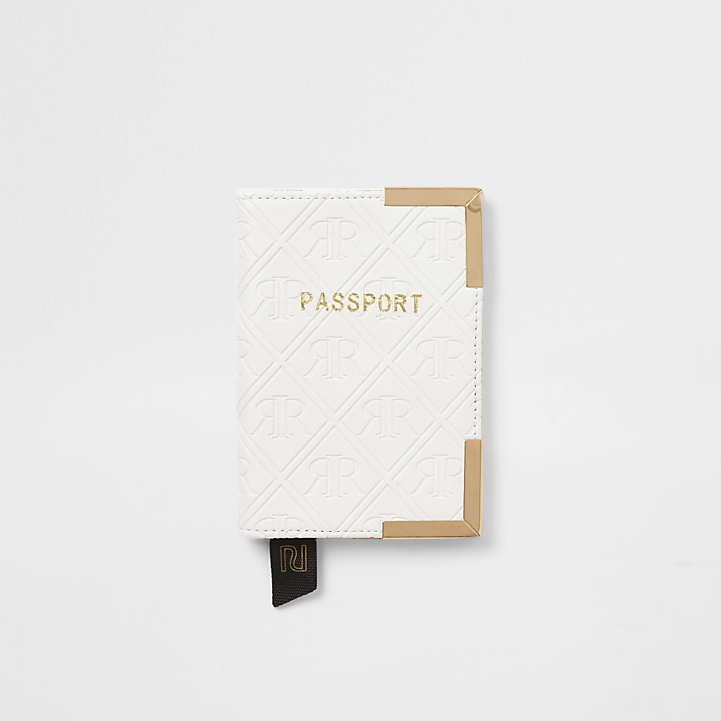 White embossed passport holder