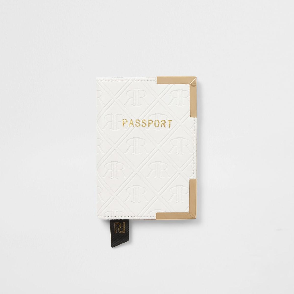 White embossed passport holder