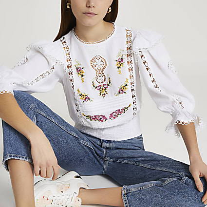 White embroidered frill detail blouse