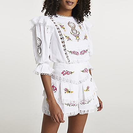 White embroidered frill detail layered shorts