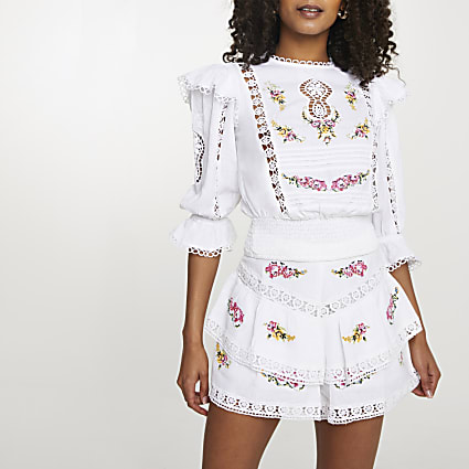 White embroidered frill sleeve top