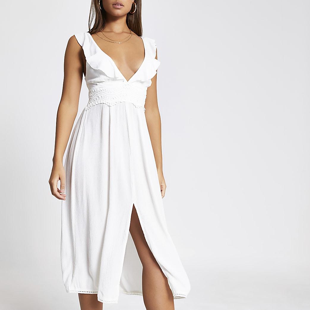 White embroidered frill V neck beach dress