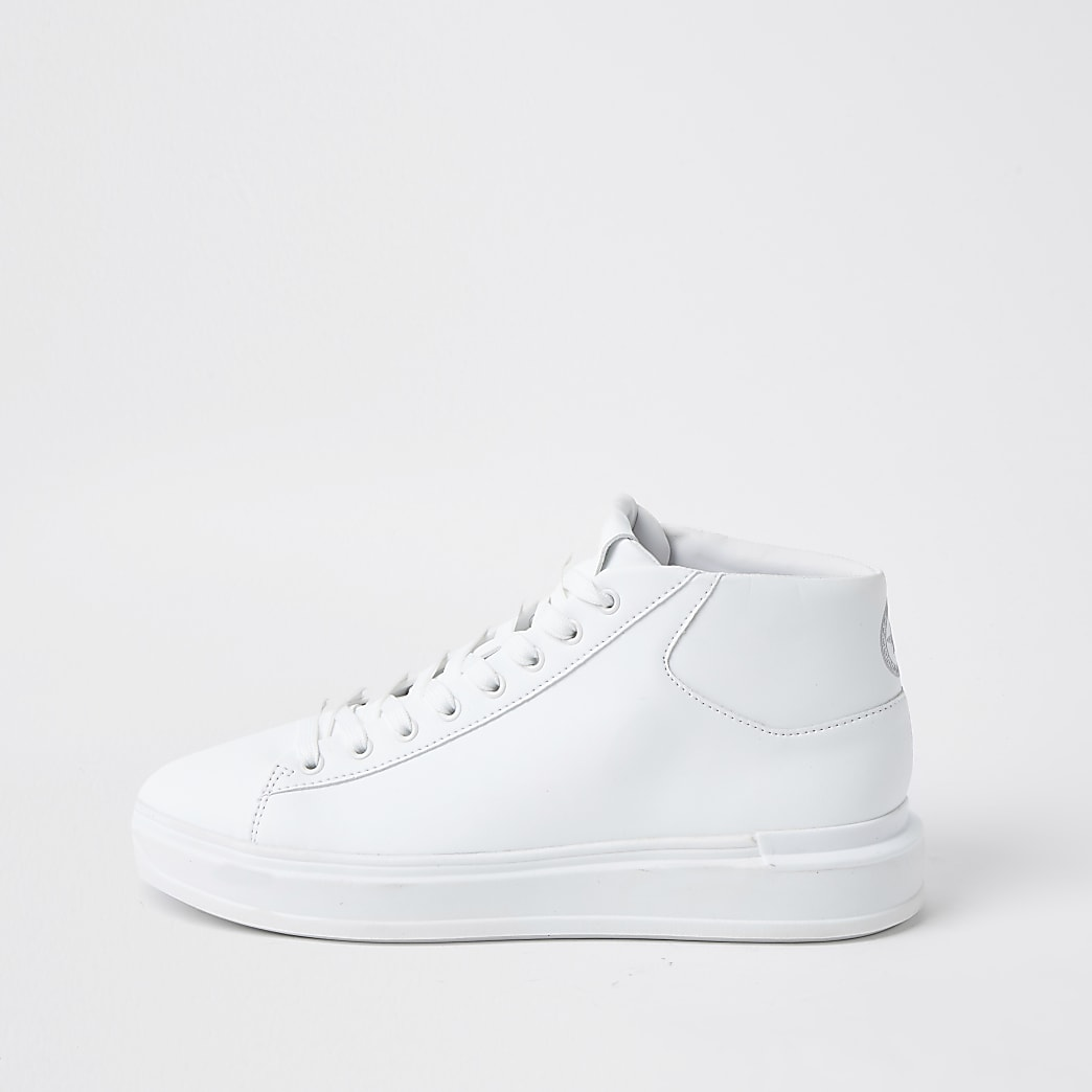 White faux leather lace up mid top trainers