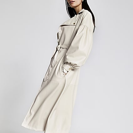 White faux leather studded belted trench coat