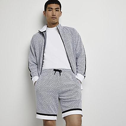 White geo print slim fit shorts