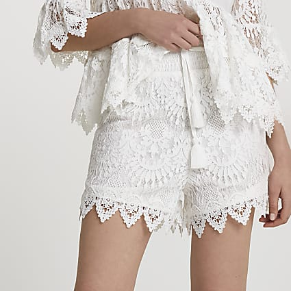 White lace runner shorts