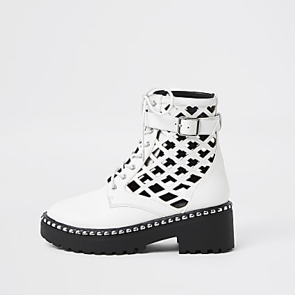 White lazer cut ankle boots