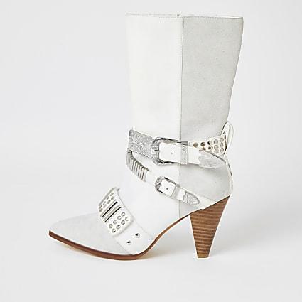 White leather embellished strap heeled boots