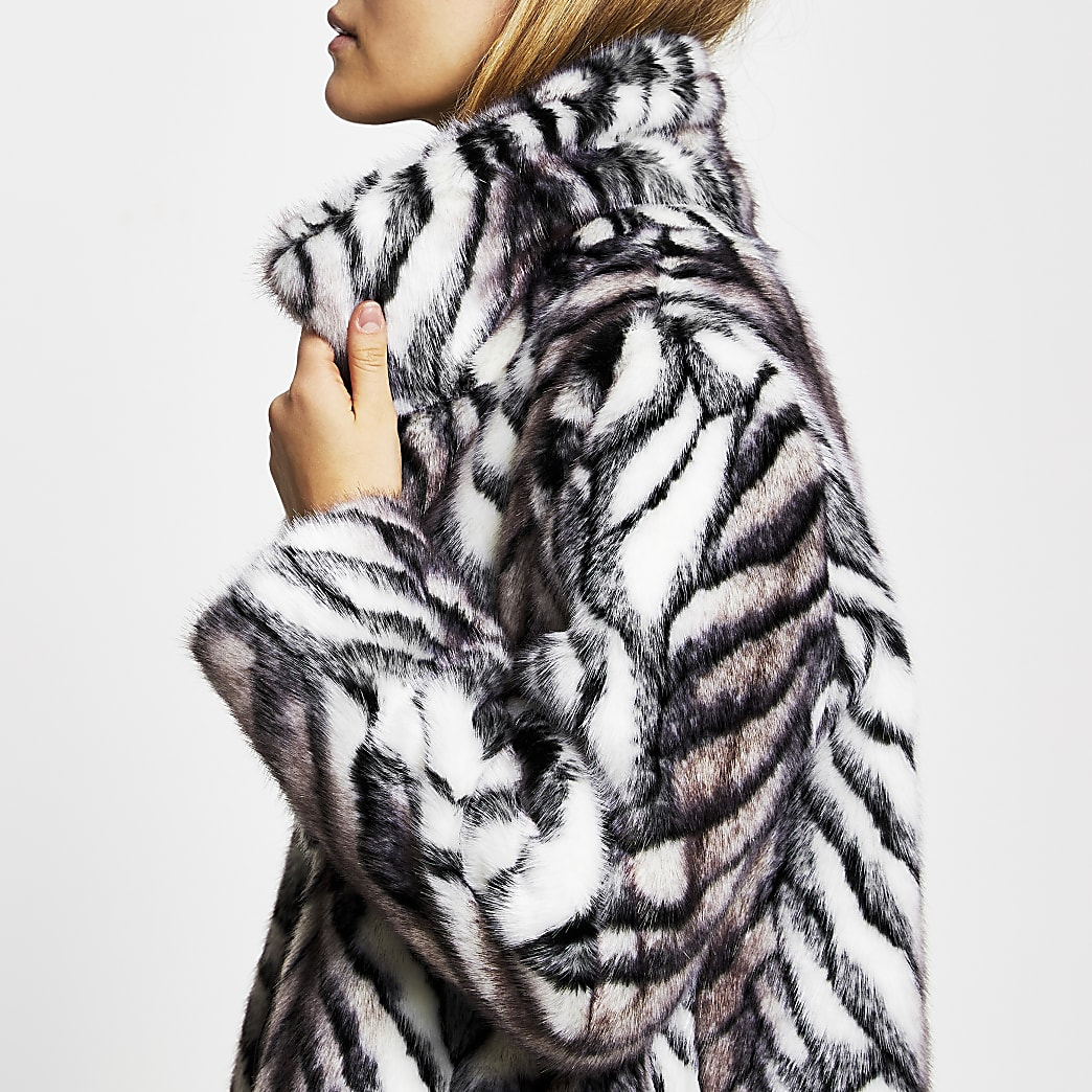 White long line faux fur zebra print coat