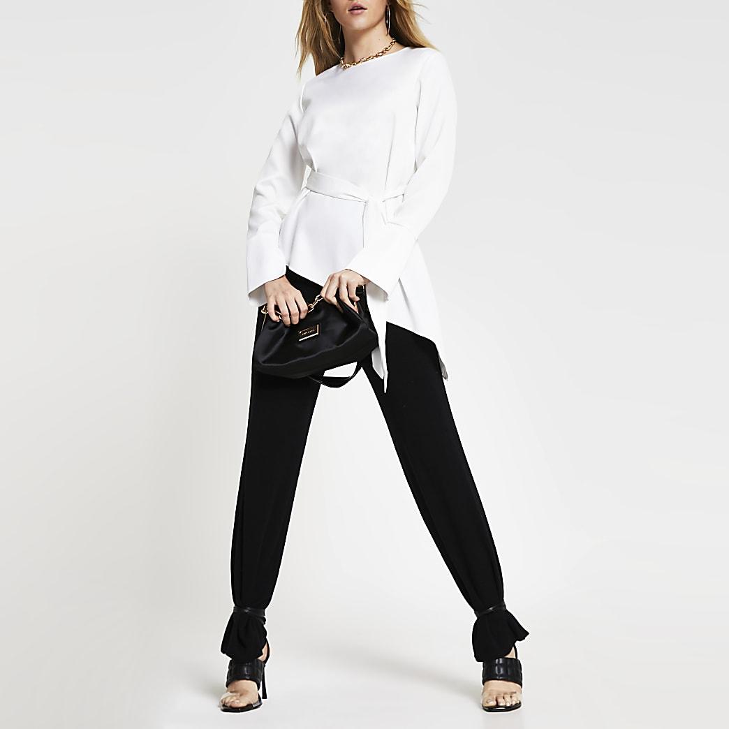 White long sleeve asymmetric hem top