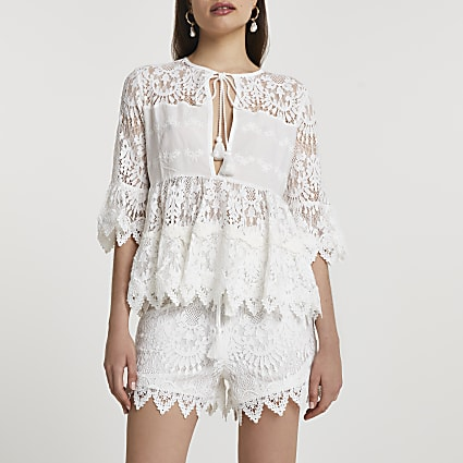 White long sleeve lace tie front blouse