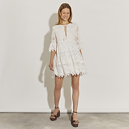 White long sleeve lace tie front mini dress