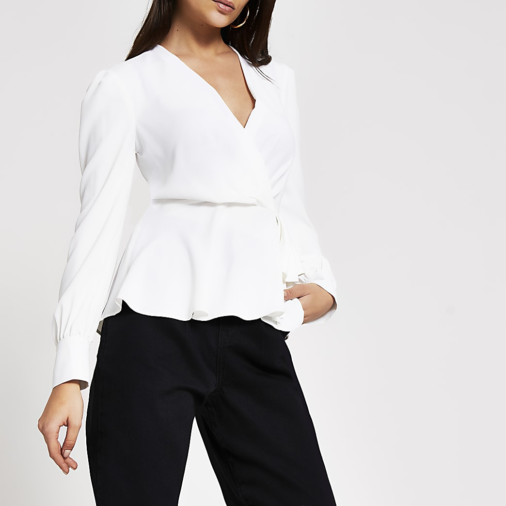 White long sleeve peplum wrap blouse