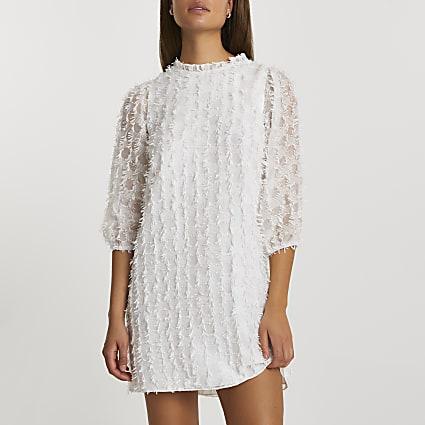 White long sleeve textured shift dress