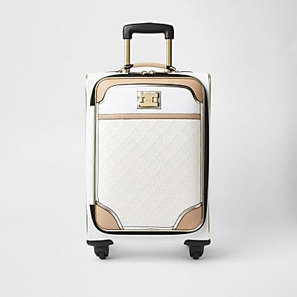 White monogram embossed suitcase