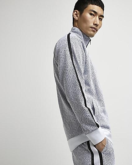 White monogram funnel neck zip jacket