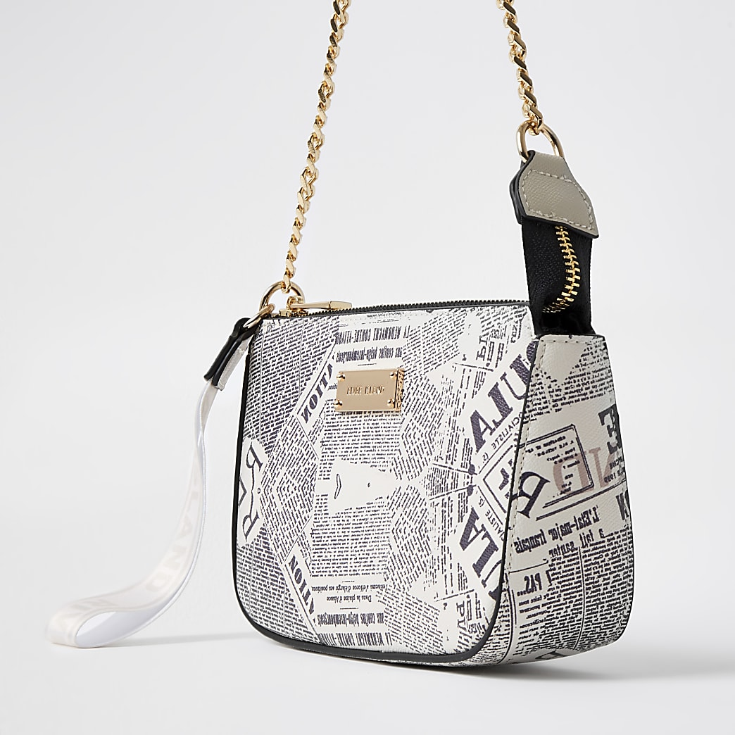 White newspaper print RI underarm bag