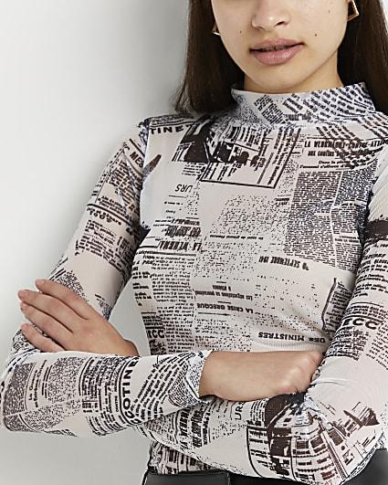White newspaper print sheer top