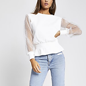 Witte shirred sweater met organzamouwen