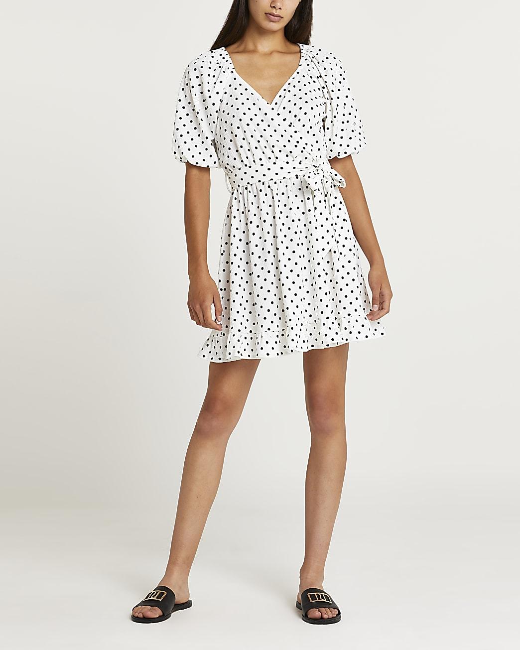 White polka dot tie waist mini dress