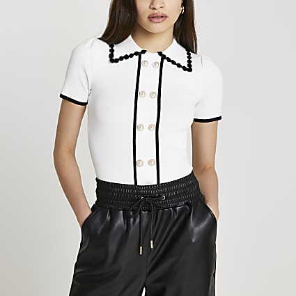 White polo neck black trim top