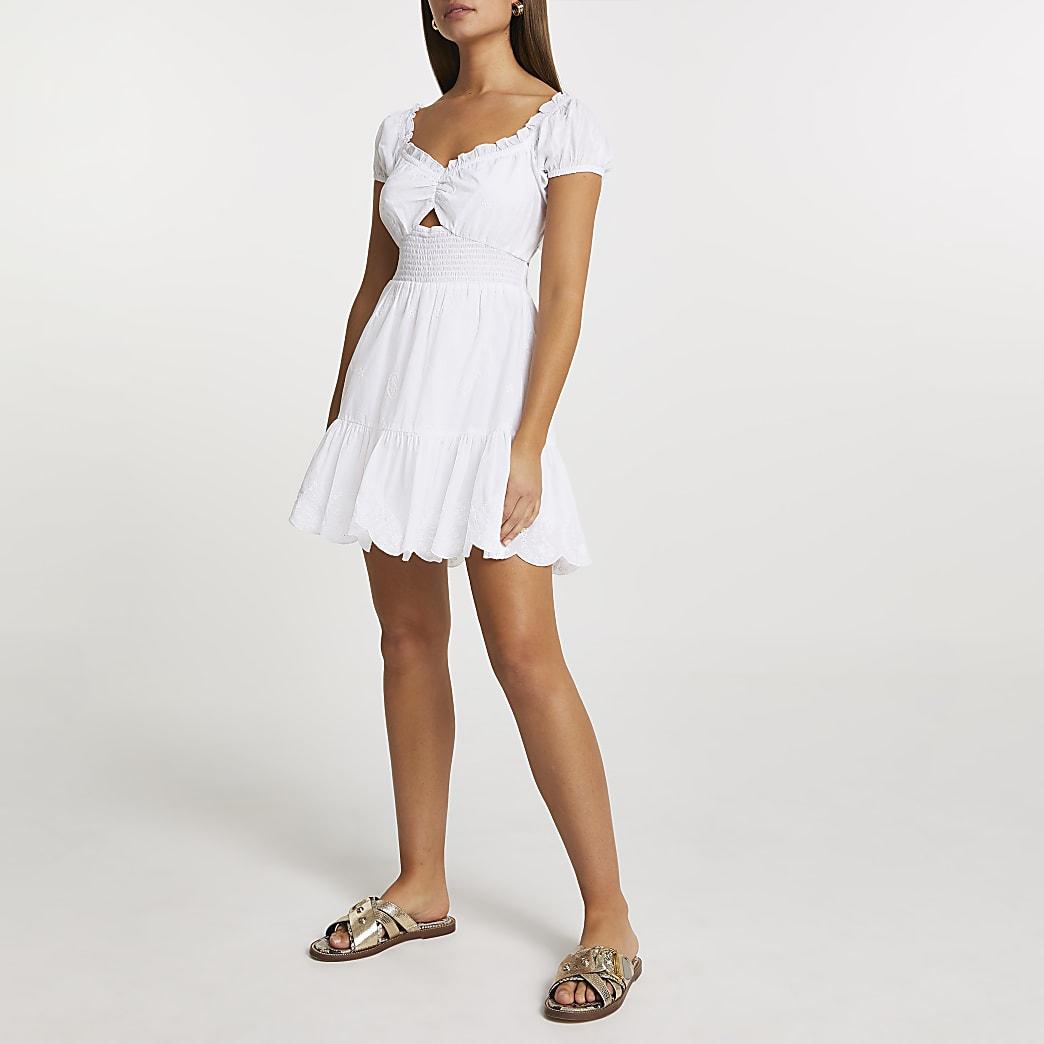 White puff sleeve shirred mini dress
