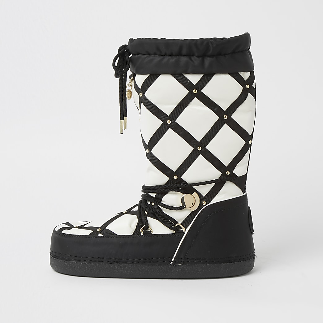 White quilted RI monogram snow boots