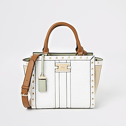 White RI embossed studded tote handbag