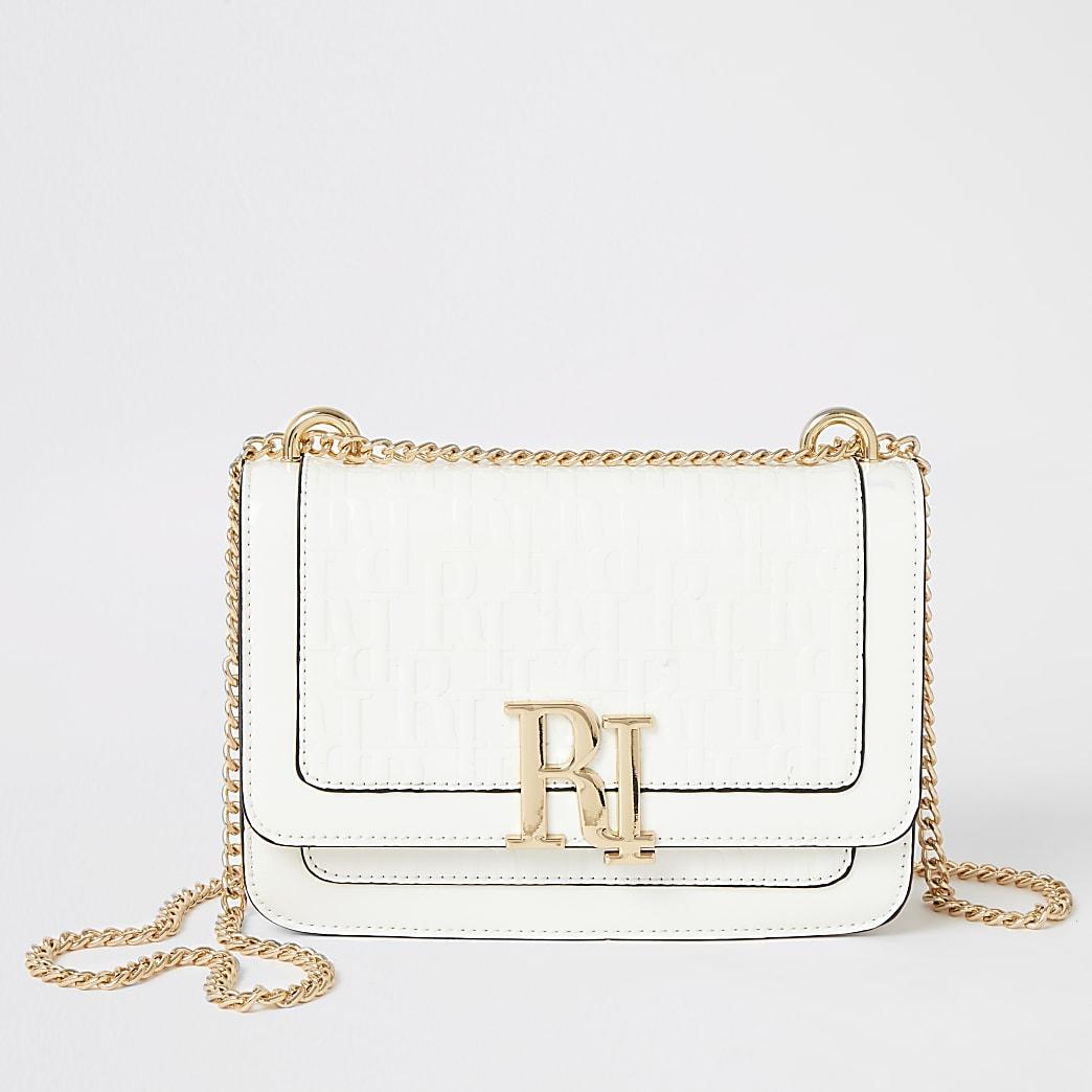 White RI embossed underarm satchel bag