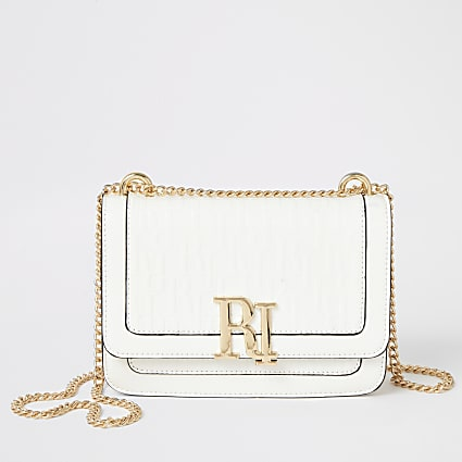 White RI embossed underarm satchel Handbag