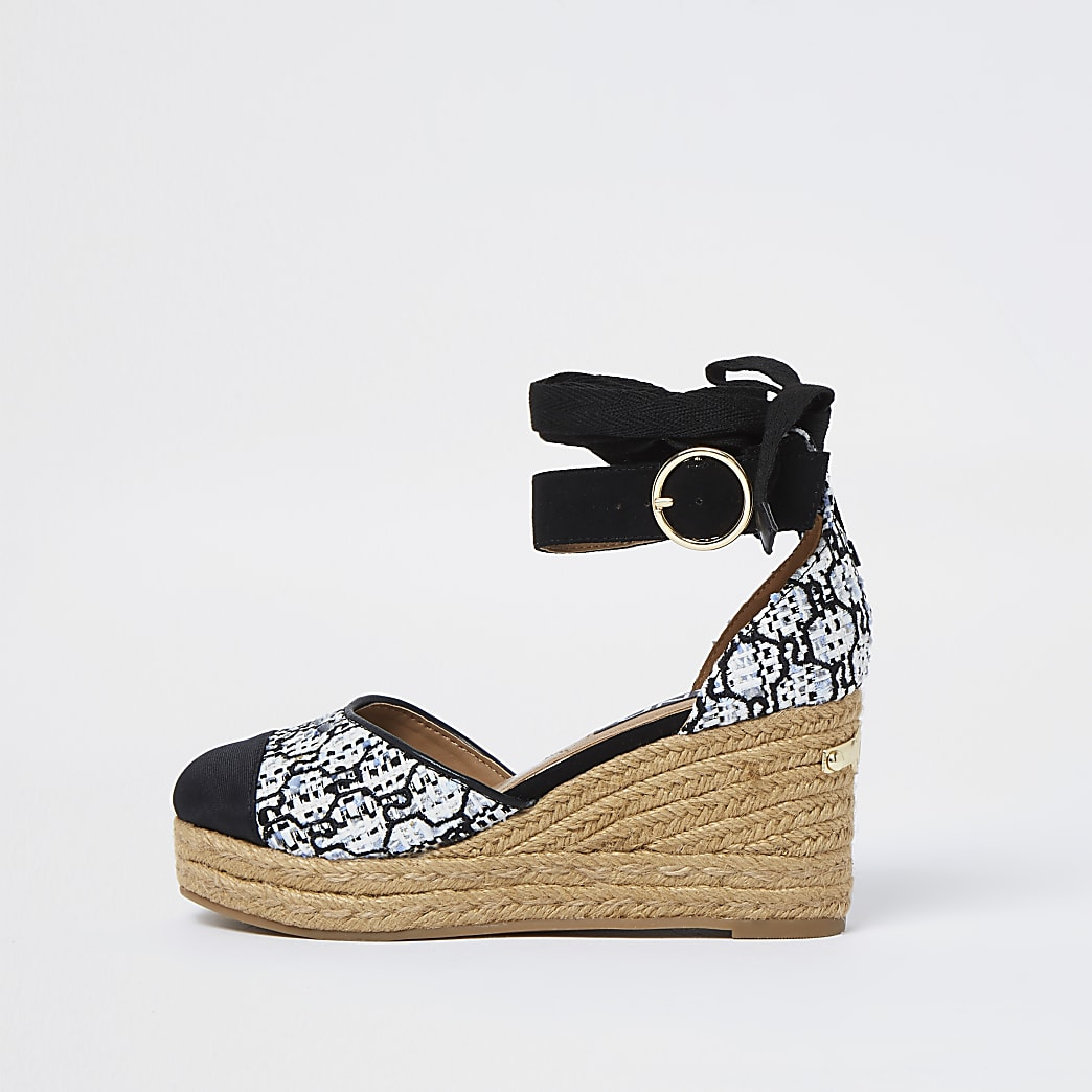 White RI monogram boucle wedges