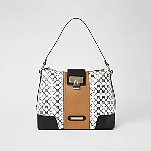 White RI monogram lock front slouch bag