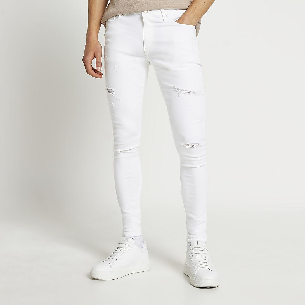 White ripped spray on skinny fit jeans