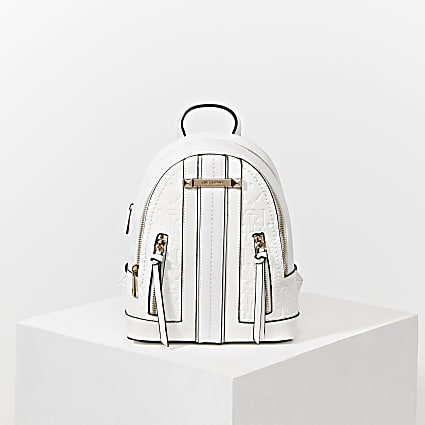 White 'River' embossed panel backpack