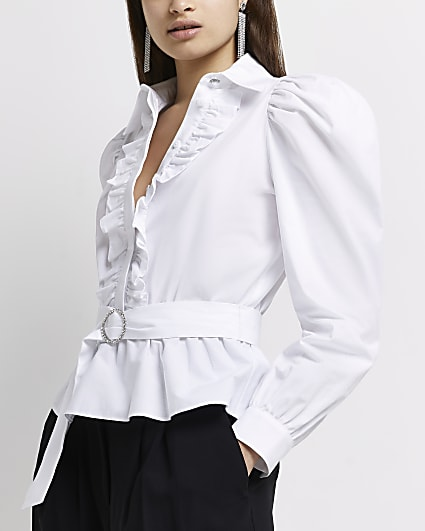 White ruffled belted blouse