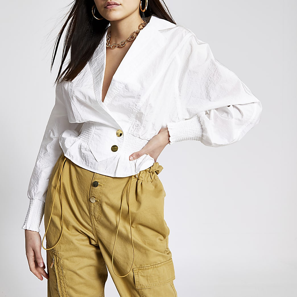 Wit overhemd van nylon met shirred taille