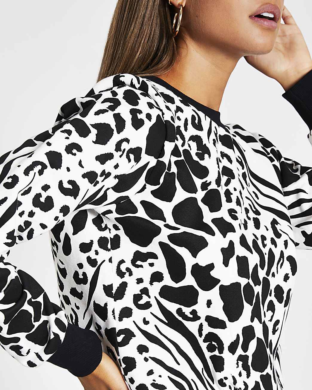 White shoulder pad animal print sweatshirt