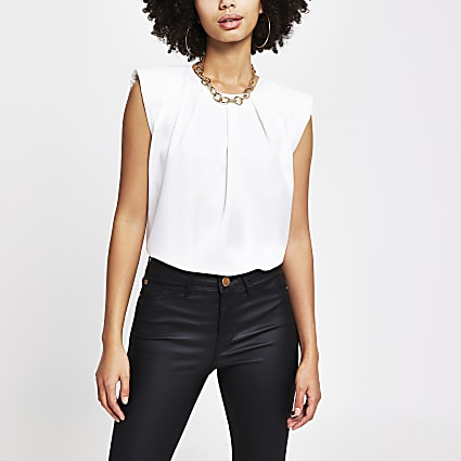 White shoulder pad sleeveless top