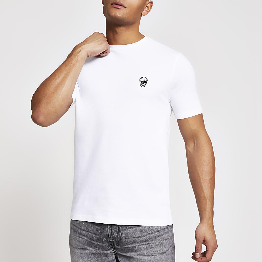Wit piqué slim-fit T-shirt met doodshoofdprint