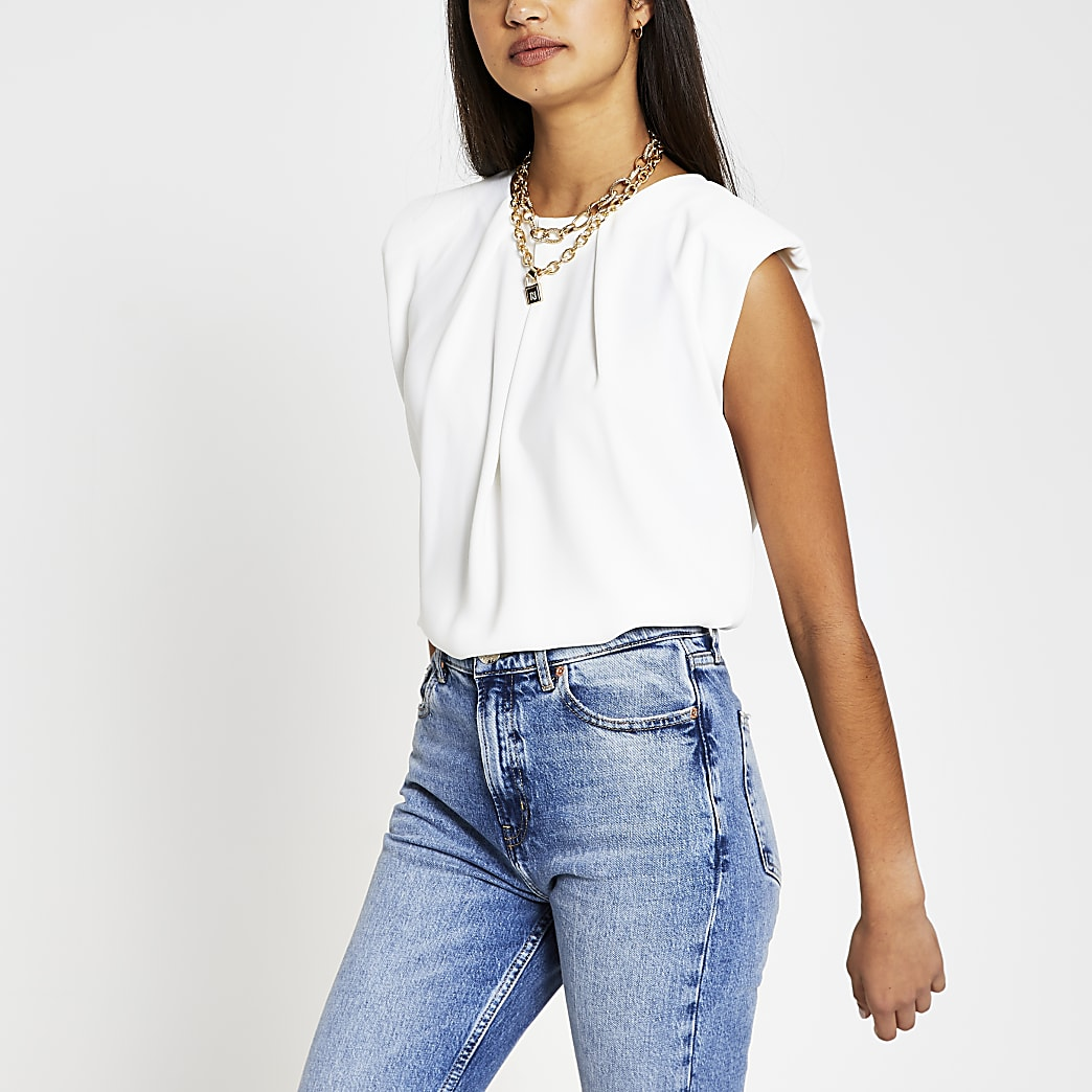 White sleeveless shoulder pad top