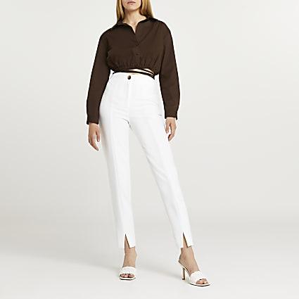 White split front cigarette leg trousers