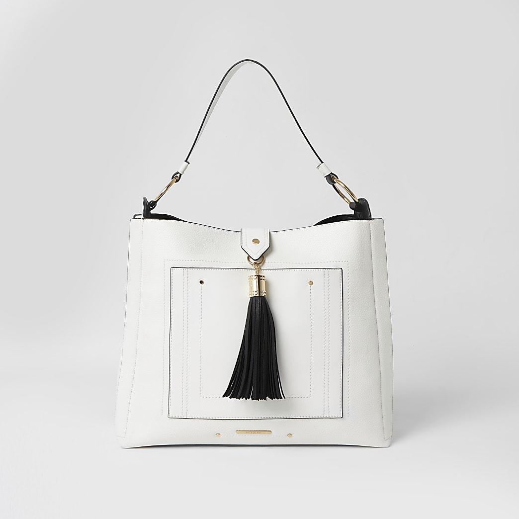 White tassel pocket front slouch bag