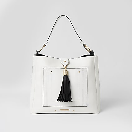 White tassel pocket front slouch handbag