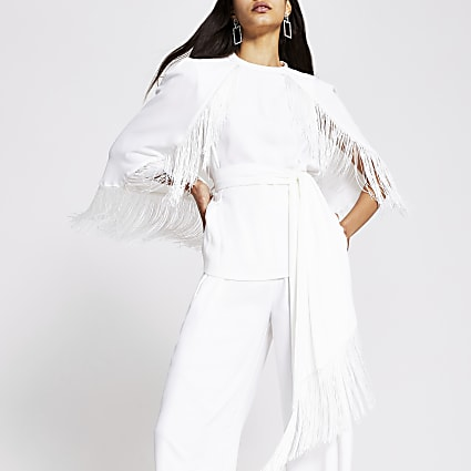 White tassel tie belted cape sleeve top