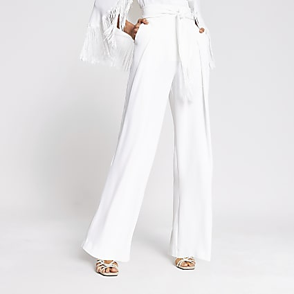White tassel tie waist wide leg trousers