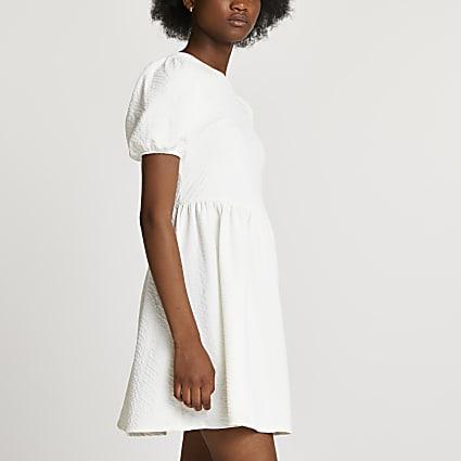 White textured bow back mini dress