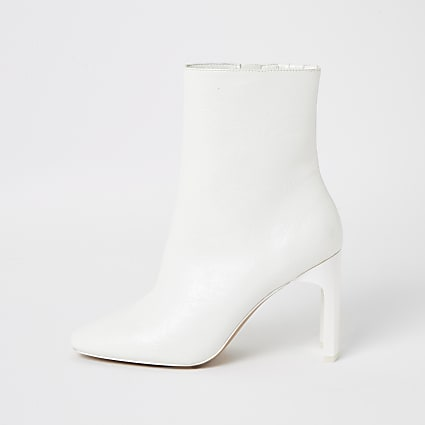 White textured high heel boots