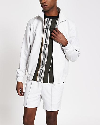 White textured zip front funnel neck jacket