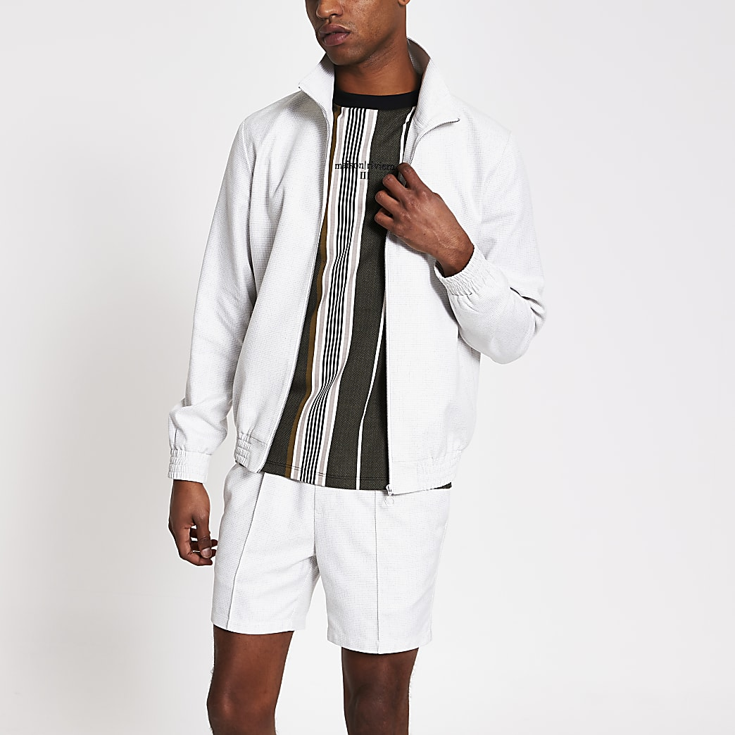 White textured zip front funnel neck jacket