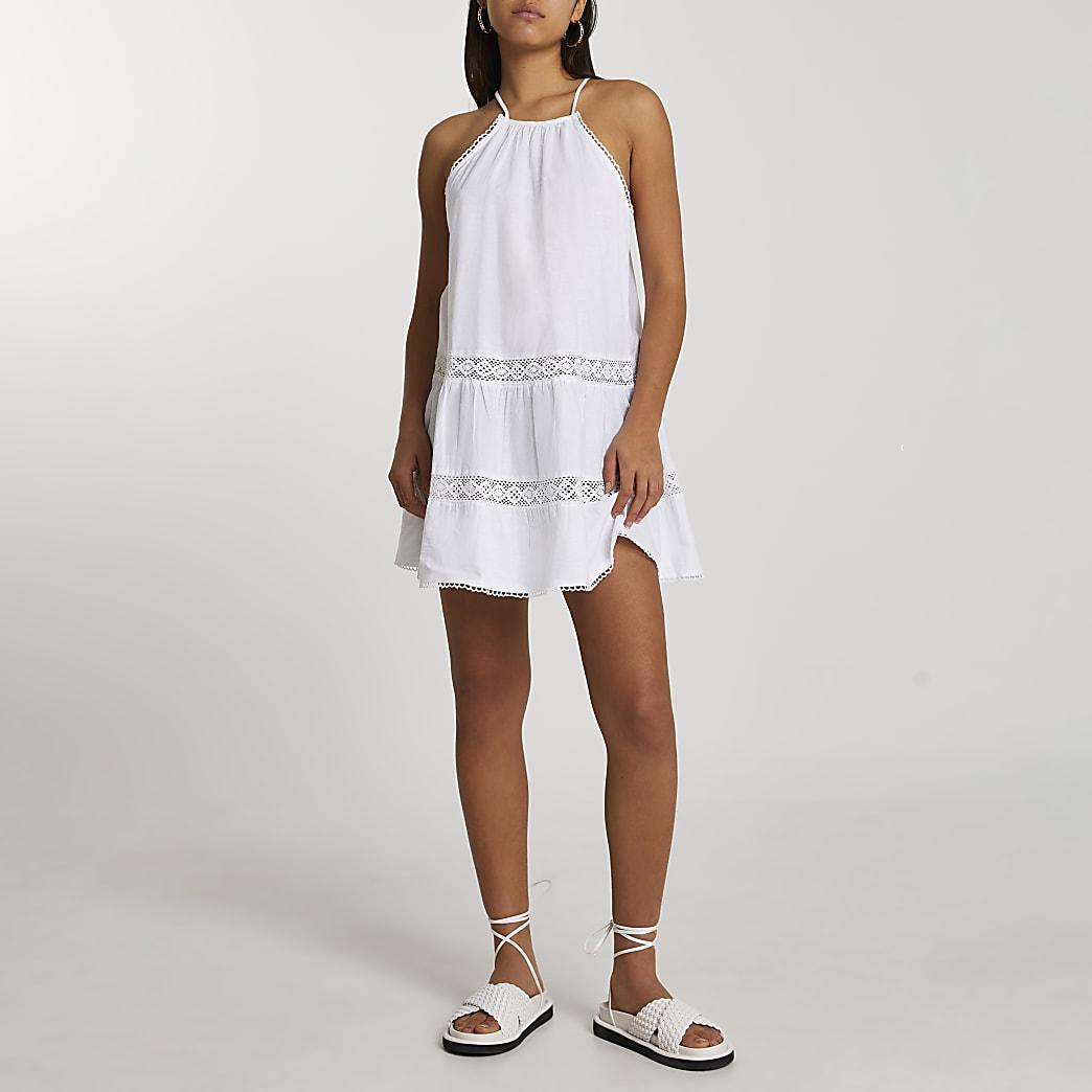 White tiered halter mini swing dress